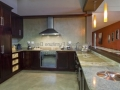 Dark wood & granite kitchen