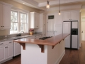 White kitchen with solid wood counter