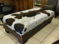 Dark brown nguni and sleeperwood ottoman