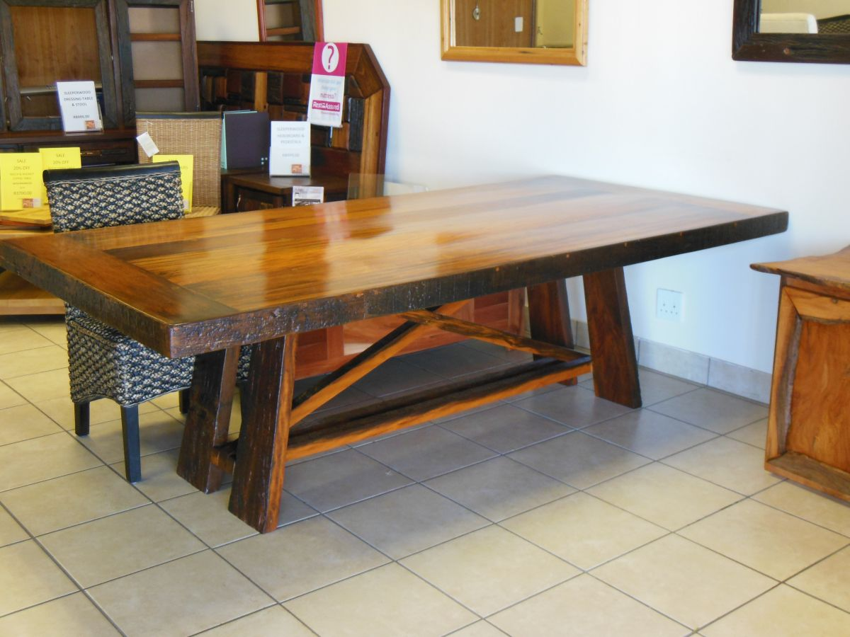 Mellowood Furniture Design Businesses in South Africa : 8 seater sleeper wood table refractory base resized from www.south-africa-info.co.za size 1200 x 900 jpeg 180kB